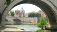 city view with stone birdge, tiber river, rome, italy video