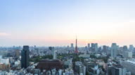 cityscape and skyline of downtown near tokyo tower at sunrise. video