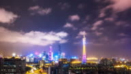 cityscape and skyline of new city near guangzhou tower at night. timelapse video