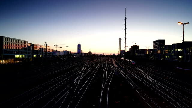 Cityscape of Munich with railway at sunset video