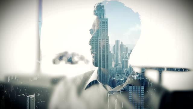 Cityscape overlay on businessman drinking coffee video