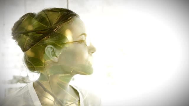 Cityscape overlay on thinking businesswoman video