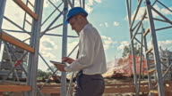 Civil engineer using digital tablet at the construction site video