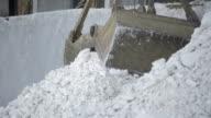 Clamshell bucket crane rakes white salt video