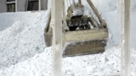 Clamshell crane gathering salt video