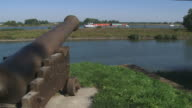 Classic Cannon at riverbank of fortified town Woudrichem video