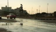 Classic cars turning on main street in Havana video