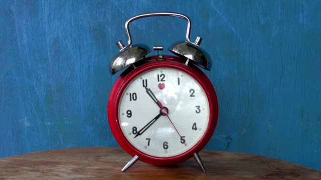 Classic old  red alarm clock arrow motion video