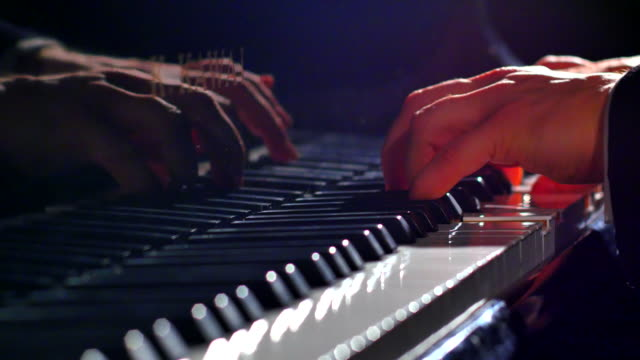 Classic Shot of Pianist Playing Grand Piano with Cinematic Stage Lighting video