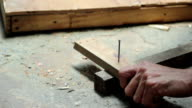 HD VIDEO Claw hammer and hand with nail video