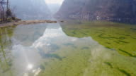 Clean bottom of lake with clear fresh water, mountain reflection video