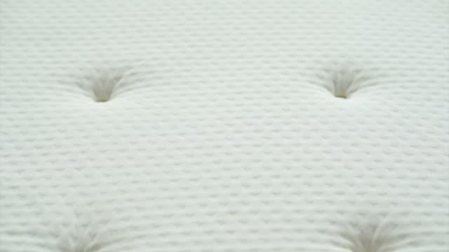 Clean white new Mattress futon bed close up texture video