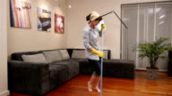 cleaning lady living room broom dance video