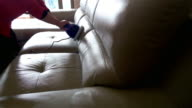 cleaning leather sofa at home with sound video