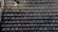 Cleaning of the newly installed wooden shingles FS700 Odyssey 7Q 4K video
