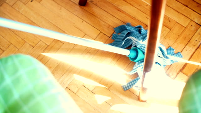 Cleaning the floor with a mop. video