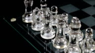Clear Glass Chess Pieces In Starting Position On Board video