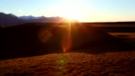 Clear Sunrise over Golden Hills and Mountains. video