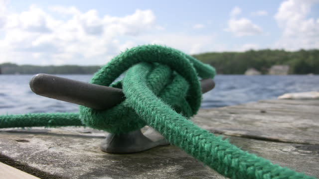 Cleat with green rope. video
