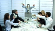 Clerks scatter the dollars at the office. video