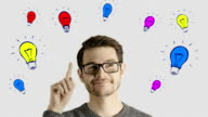 Clever creative man think gets an idea, which jumps up as symbolic colored cartoon animation shape lamps over his head on white background video