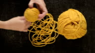 Clewing the yellow yarn up video