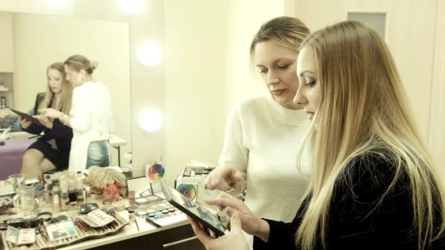 Client make selfie with makeup artist using tablet video