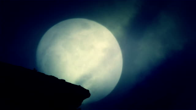 A Cliff at Night on a Rising Full Moon Background on a Spooky Night video