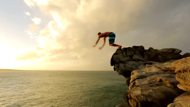 Cliff Jumping at Sunset. Summer Extreme Sports Cliff Jumping Outdoor Lifestyle. Cliff Jumping at Sunset. video
