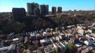 Cliffside Park NJ Flying Over Homes Towards Apartment Buildings With Blue Skies video