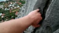 Climber ascends ridge crest above village video