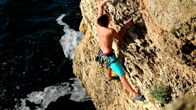 Climber Climbing On A Rock video