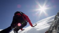 Climber climbs on a snow-covered mountain video