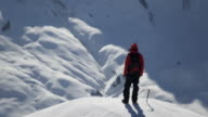 Climber exultant on a snow-covered mountain video