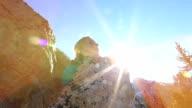 Climber grabs last rock at top of mountain peak video