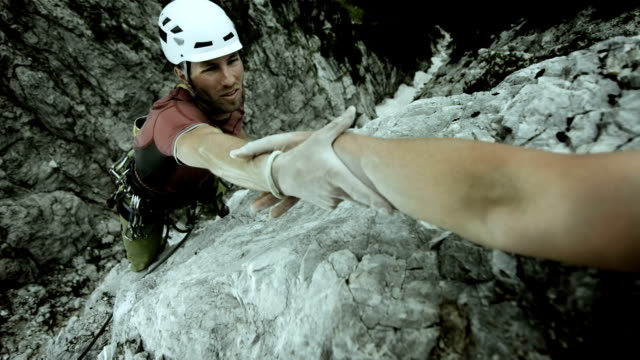 HD: Climber Reaching For A Helping Hand video