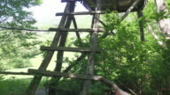 Climbing on a wooden hunting observatory. Walking point of view. video