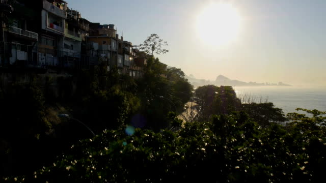 Climbing sunrise aerial of hillside favela looking over sea and mountains video