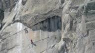 Climbing team below giant roof big alpine wall Chamonix video