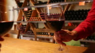 Clinking red wine glasses video