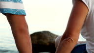 Clinking wineglasses on the wild sunny seaside video