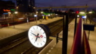 Clock in a small train station time lapse video