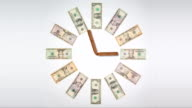 Clock of twelve different US dollar banknotes and luxury cigars video