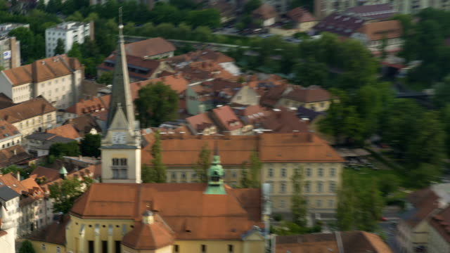 Clock on ancient church tower in European city, cultural heritage preservation video