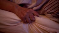 cloesup of old woman's hand lying in bed video