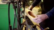 Clog maker drills a hole in the side of clog [Slomo] video