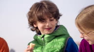 close: boy, 9 years, eating ice cream outdoors video