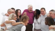 Close group of mixed age and senior people video