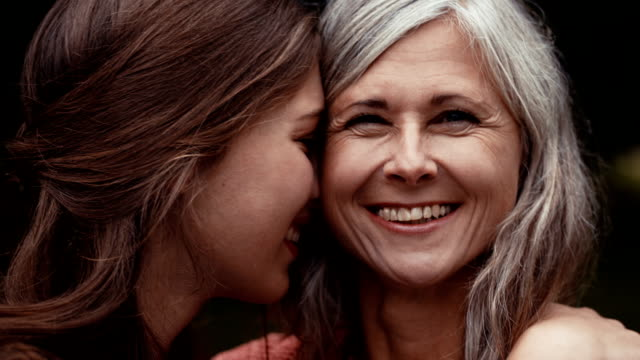 Close mother and daughter have a happy moment together video