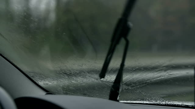 HD SLOW: Close shot of wiper pushing water off video